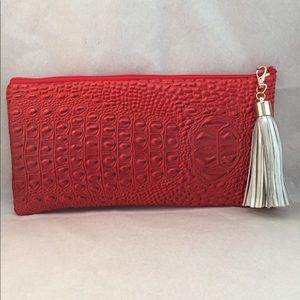 Red oblong vinyl clutch bag